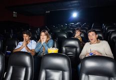 Shocked People Watching Film Royalty Free Stock Photography