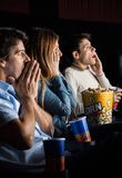 Shocked People Watching Movie Royalty Free Stock Photos