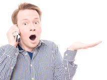 Shocked phone call presents Stock Photo
