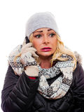 Shocked phone call. A woman talking on a cell phone dressed for winter has a shocked expression on her face royalty free stock photography