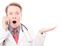 Shocked phoning physician presents Stock Image