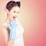 Shocked pin-up cleaner girl with funny expression Royalty Free Stock Image