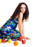Shocked pretty girl with ripe fruits Royalty Free Stock Images