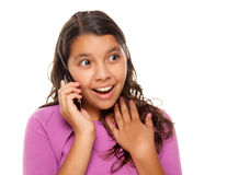 Shocked Pretty Hispanic Girl On Cell Phone Stock Photography