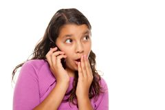 Shocked Pretty Hispanic Girl On Cell Phone Royalty Free Stock Image