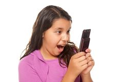 Shocked Pretty Hispanic Girl On Cell Phone Royalty Free Stock Images