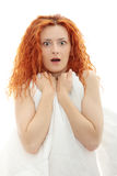 Shocked redhead woman Stock Images