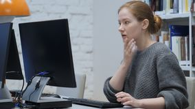 Shocked Redhead Woman, Upset while Working on Computer. 4k , high quality stock video footage