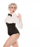 Shocked retro burlesque dancer in bow tie, frilled shirt & corse Stock Photography