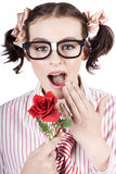 Shocked Romantic Nerdy Girl Holding Red Rose Royalty Free Stock Photography