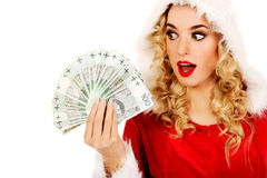 Shocked santa woman holding a clip of polish money Royalty Free Stock Photo