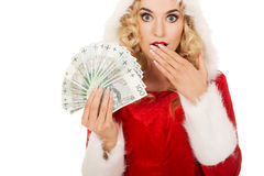 Shocked santa woman holding a clip of polish money Stock Photos