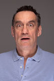 Shocked Scared Man on Grey Background. Portrait of Shocked Scared Middle Age Man on Grey Background stock images