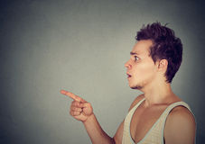 Shocked scared man pointing finger at someone Royalty Free Stock Photo