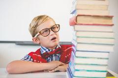 Shocked schoolkid pretending to be a teacher in classroom Royalty Free Stock Image