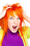 Shocked screaming woman holding red head. Closeup portrait of shocked screaming woman holding red head with hands Royalty Free Stock Images