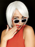 Shocked Secretive Young Woman Wearing Sunglasses Stock Image