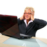 Shocked Senior Business Woman In Front Of Laptop Stock Photography