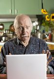 Shocked Senior Man with a Laptop Computer Royalty Free Stock Image