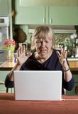 Shocked Senior Woman with a Laptop Computer Royalty Free Stock Photo