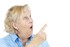 Shocked senior woman pointing royalty free stock image