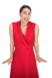 Shocked sexy brunette in red dress posing Royalty Free Stock Photos