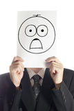 Shocked smile. Man with the painted shocked smile on the sheet of paper over his face isolated on white Stock Photo