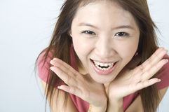 Shocked smile looking asian girl Stock Photo