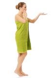 Shocked spa woman holding something on palm. Stock Photo