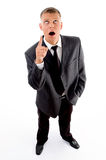 Shocked standing businessman pointing upside Stock Images