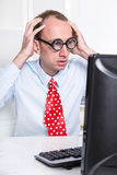 Shocked and stressed business man with lenses and a red tie at d Stock Image