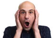 Shocked stressful bald man keeps hands on head. Headshot of shocked stressful bald man keeps hands on head, isolated over white blank wall. Wondered and amazed stock photos
