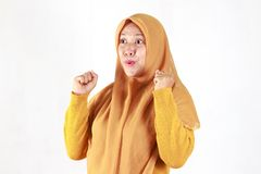 Shocked, stressful , tired and frustrated face expression. Of Muslim asian woman wearing hijab isolated over white background royalty free stock photos