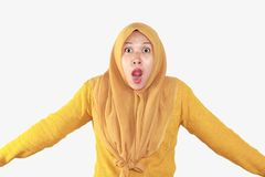 Shocked, stressful , tired and frustrated face expression. Of Muslim asian woman wearing hijab isolated over white background royalty free stock image