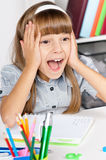Shocked student girl in school Royalty Free Stock Image