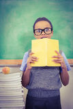 Shocked student holding a book Stock Images
