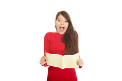 Shocked student woman with her note. Royalty Free Stock Images