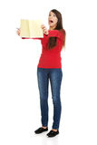 Shocked student woman with her note. Royalty Free Stock Photography