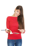 Shocked student woman with her note. Stock Photo