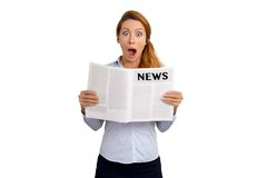 Shocked stunned funny looking woman reading newspaper Royalty Free Stock Image