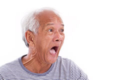 Shocked, stunned, unhappy old man with surfer's eye or pterygi Stock Images