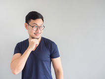 Shocked and surprised Asian man with eyeglasses looking at empty stock image