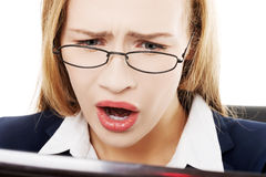 Shocked, surprised business woman sitting in front of laptop. Royalty Free Stock Photography