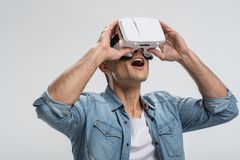 Shocked surprised man experiencing virtual reality stock photography
