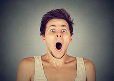 Shocked surprised man in full disbelief screaming royalty free stock photography