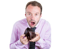 Shocked, surprised speechless man, worker, businessperson holding an empty wallet Stock Image