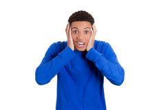 Shocked and surprised young handsome man with hands on head Royalty Free Stock Image
