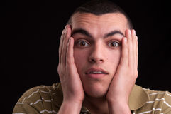 A shocked and surprised young man looking at the camera Stock Images
