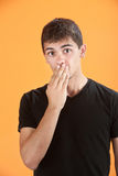 Shocked Teen. Latino teen with hand on his mouth Royalty Free Stock Photos