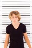 Shocked teen boy. Taking police mug shot Royalty Free Stock Images